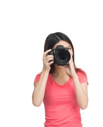 Young asian female photographer happy with her new camera. Isolated on white.