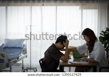 Young Asian female therapist doctor is smiling and touching patient's shoulder for encouragement. Patient got bad news, he want reassuring in hospital room. Medical healthcare concept. #1390127429