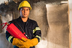 Young asian Fireman,Firefighters use fire  extinguishing that are burning in the building.