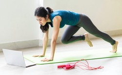 Young asian girl doing exercise on the floor alone