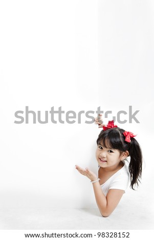 Young Asian girl holding a blank white card.