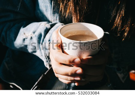 Young Asian Girl Holding Hot Coffee Chocolate Cup in the Hand #532033084