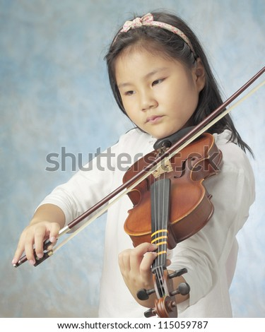 young asian girl long hair played violin against sky blue background