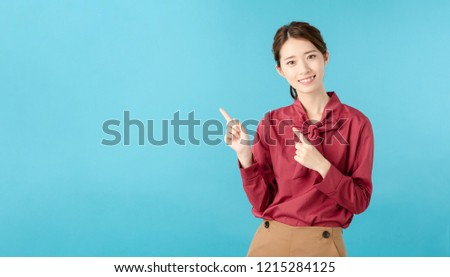 Young asian girl pointing a copy space.