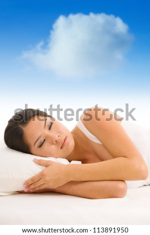 Young Asian girl sleeping on a pillow with white cloud over her top
