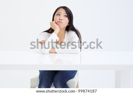 Young asian girl thinking