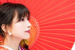Young asian girl wearing kimono (Japanese traditional clothes).