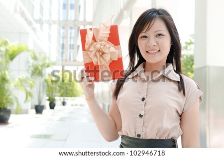 young asian girl with a present