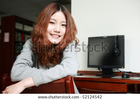 young asian girl with computer