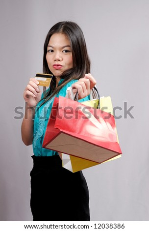 Young asian girl with shopping bags
