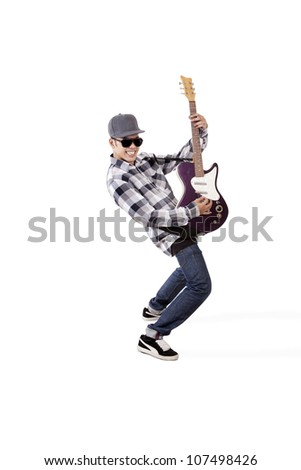 Young asian guitarist playing guitar. shot in studio isolated on white