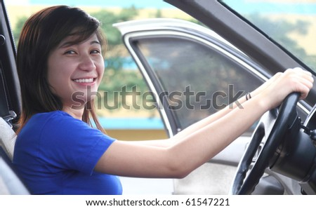 young asian happy lady driver