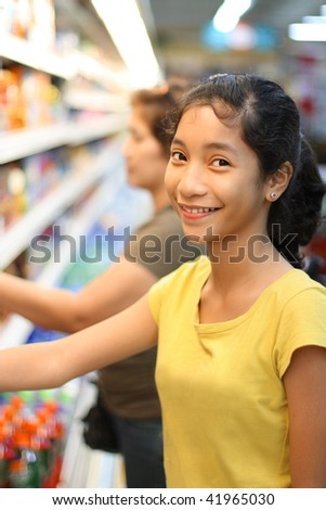 young asian lady enjoying shopping at the grocery