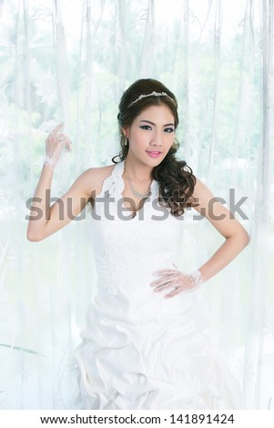 Young Asian lady in white bride dress, Model is Thai Ethnicity