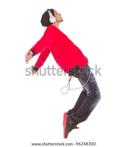 Young asian man dancing with stylish clothes. Isolated over white.