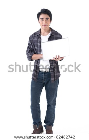 Young asian man holding laptop computer and work