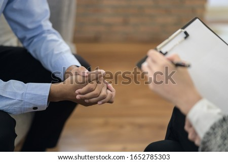 Young Asian man received a treatment from psychologist at clinic. Photo stock ©