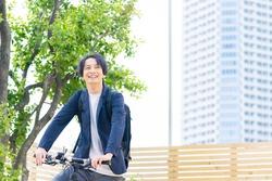 Young asian man riding a bicycle.