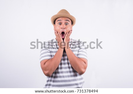 Young asian man Shocked and surprised. Astonishment and surprise concept. #731378494
