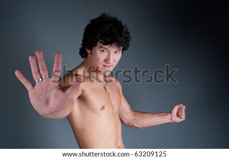 young asian man stop hand angry portrait - stock photo