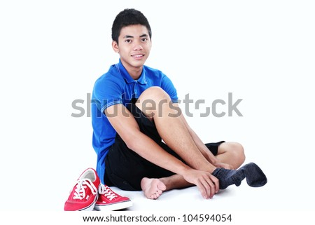 Young asian man wearing a sock. - stock photo
