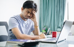 Young asian men are stressed from work, Office Syndrome