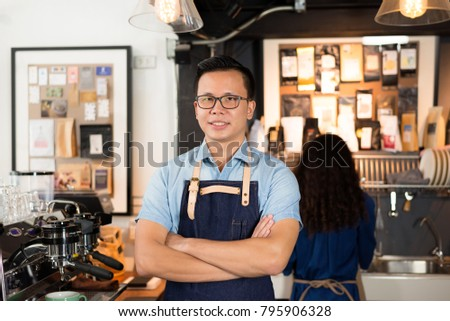 Young asian men barista smiling at coffee shop counter background, start up small business owner food and drink concept. #795906328