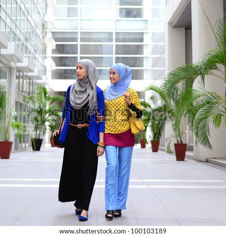 young asian Muslim woman in head scarf walk together