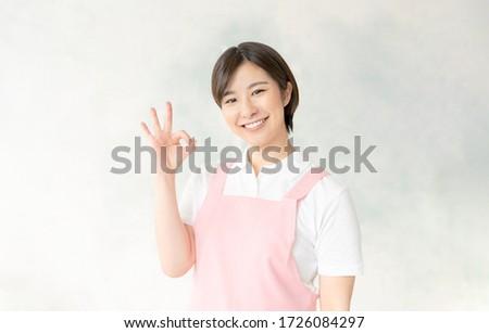 Young asian nursery school teacher showing OK sign. ストックフォト ©