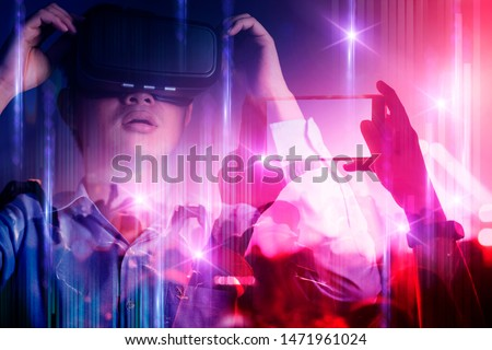 young asian officer man playing vr goggle and hand touch effect of magic of Virtual reality  in live concert music performance virtual reality atmosphere event