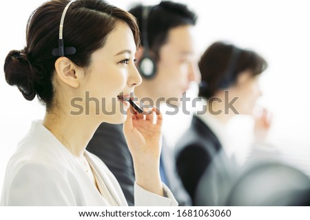 Young asian operator in the office. Group of businessperson. Photo stock ©