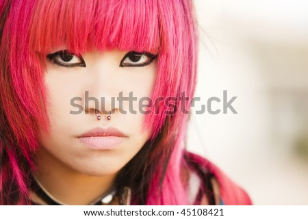 Young asian pink haired girl portrait