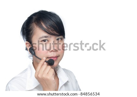 Young asian receptionist talking on hands free headset to customer isolated.