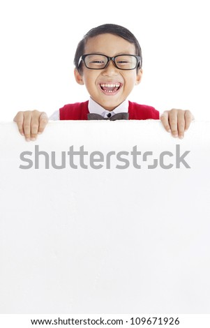 Young asian schoolboy showing blank copy space. shot in studio isolated on white - stock photo