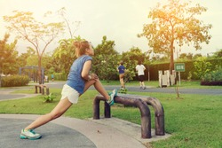 Young Asian Sport Woman Exercise in Outdoor Public Park Background - Lifestyle Workout Concept
