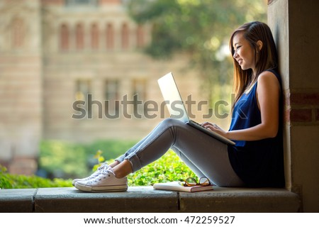 Young asian student on university campus with computer laptop  ストックフォト ©