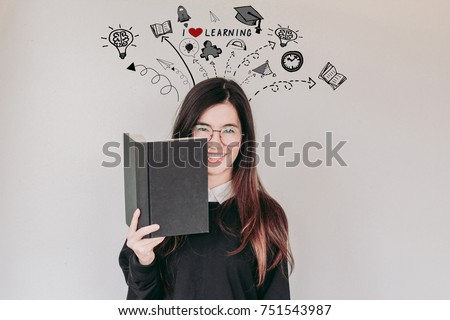 Young asian student woman holding book with learning doodles - I love learning concept
