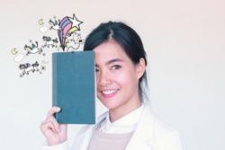 Young Asian Student Woman  reading a book with unicorn and rainbow illustration doodles- imagination concept