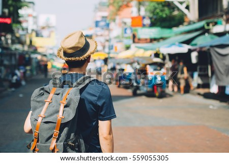 Young Asian traveling backpacker in Khaosan Road outdoor market in Bangkok, Thailand #559055305