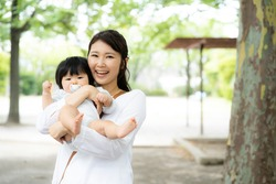 Young asian woman and baby in the park