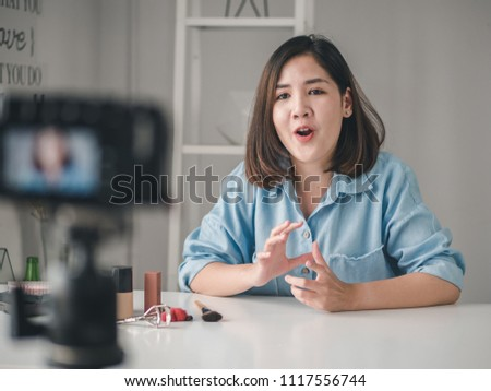 Young asian woman beauty fashion blogger recording video, Vlogger recording broadcast at home.