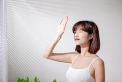 Young asian woman dislike the sunshine because afraid of suntan and oily skin