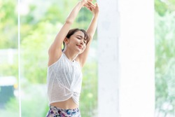 Young asian woman doing stretch. Health care. Body care.