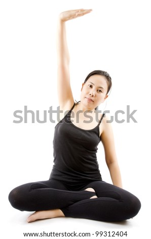 Young Asian woman doing yoga exercise.
