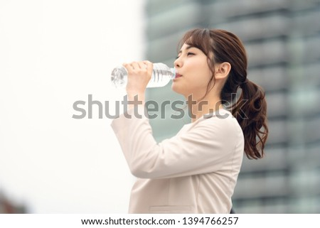 Young asian woman drinking a bottle of water. Hydration concept. Сток-фото ©