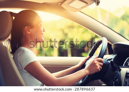 young asian woman driver driving a car,vintage effect