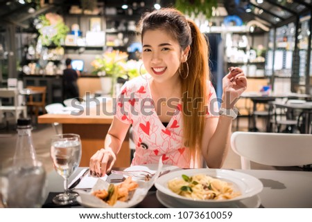 Young asian woman eating thai food at restaurant #1073610059
