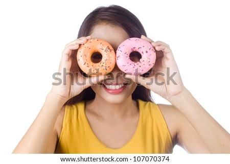 Young asian woman enjoy eating couple of  sweet colorful donut on white background