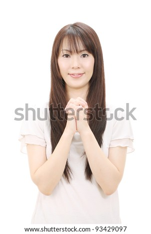 Young asian woman holding hands together - stock photo