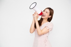 Young Asian woman holding megaphone isolated on white background, Speech and announce concept
